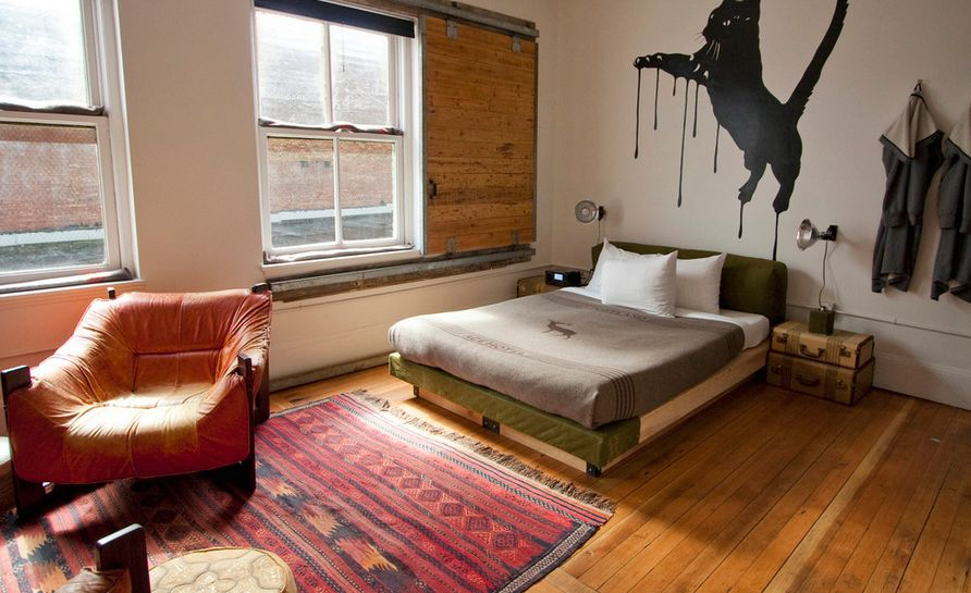 bedroom-featuring-a-wooden-barn-sliding-for-window